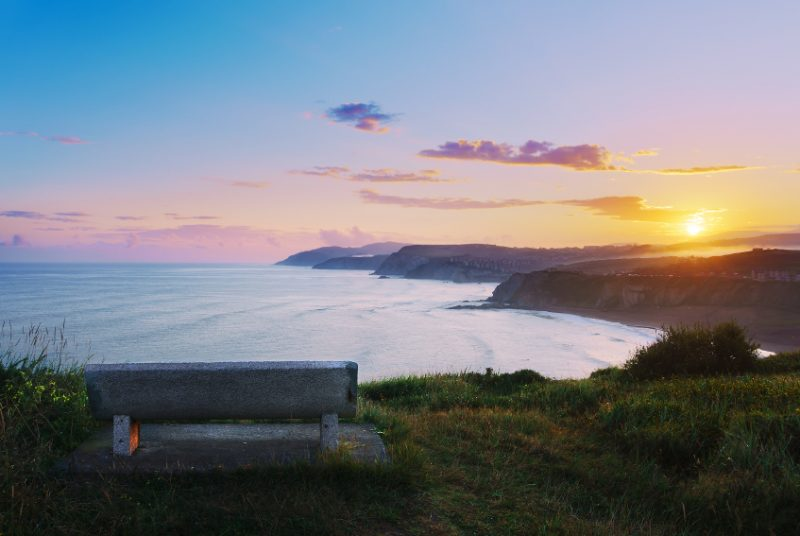 bench with view of Sopelana coast at the sunrise