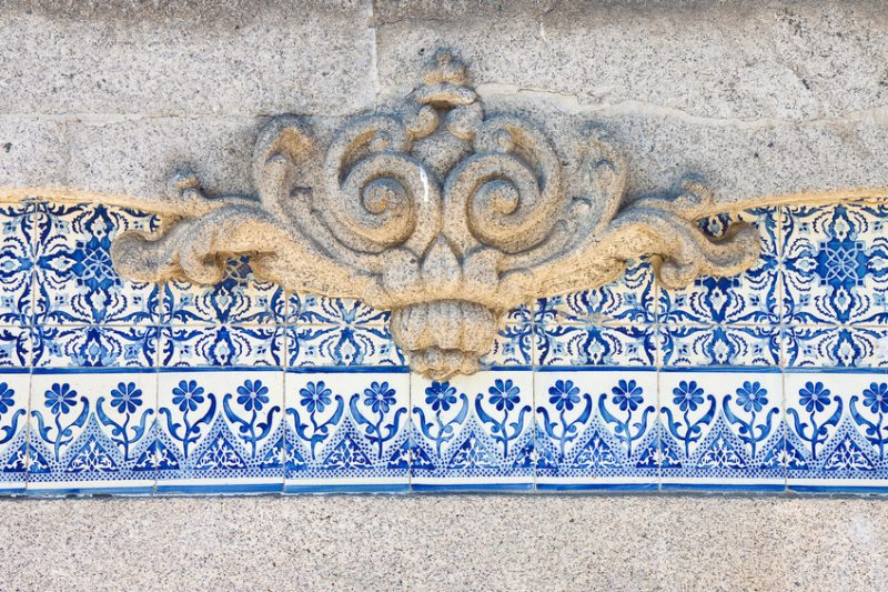 Typical Portuguese decorations with colored ceramic tiles and baroque carved frame