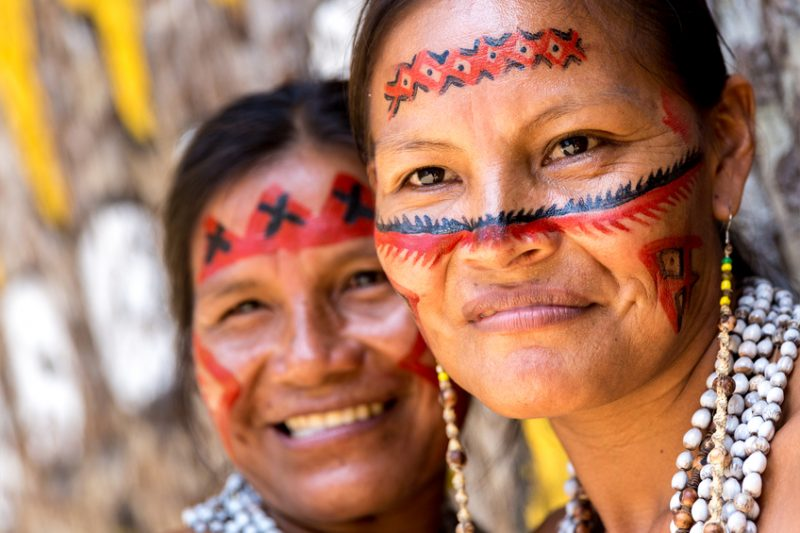 Native Brazilian women portrait at an indigenous tribe in the Amazon