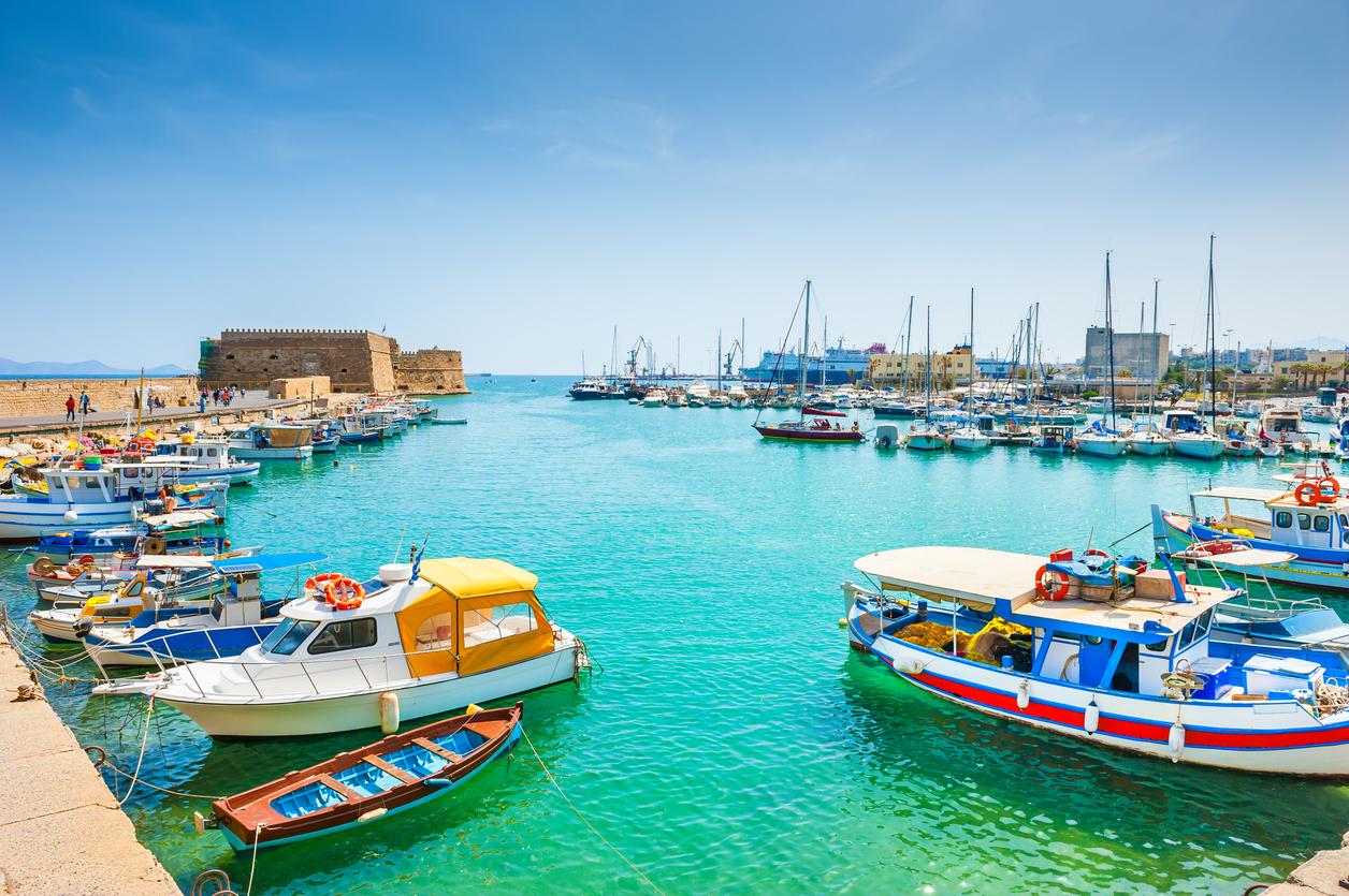 Old venetian harbor with boats in Heraklion, Crete island, Greece