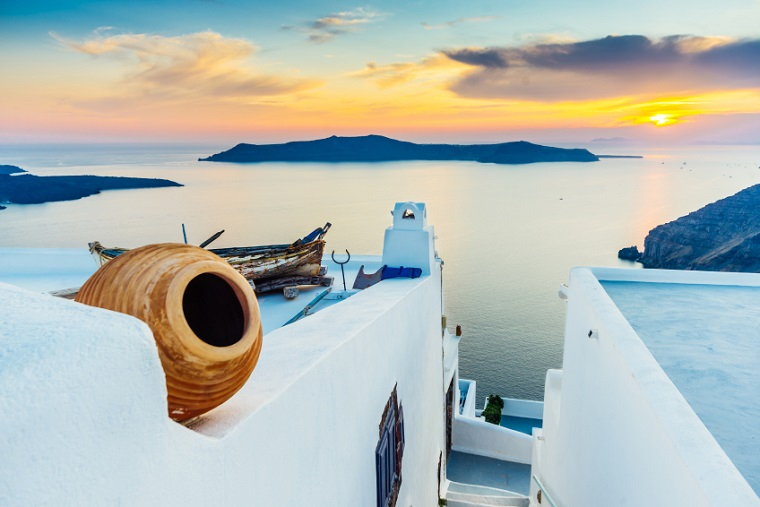 Sunset on Santorini and view of volcanic caldera, Santorini, Cyclades, Greece