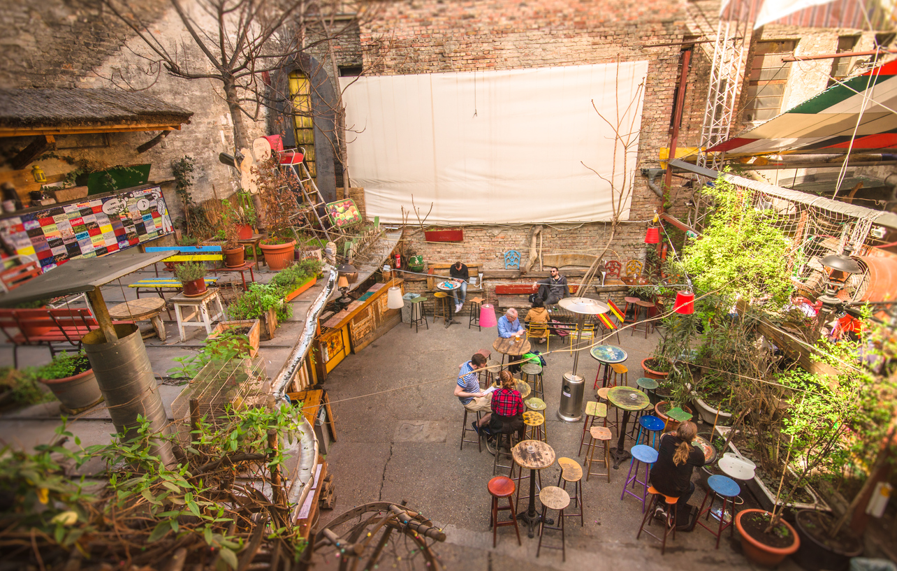 Outdoor terrace of one of the most attractive and touristic ruin pubs in Budapest, the Szimpla Kert.