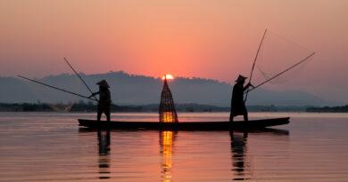 Fisherman working at sunrise, Mae Klong River, Thailand