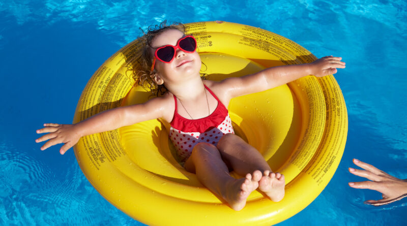 Little girl swims in  pool