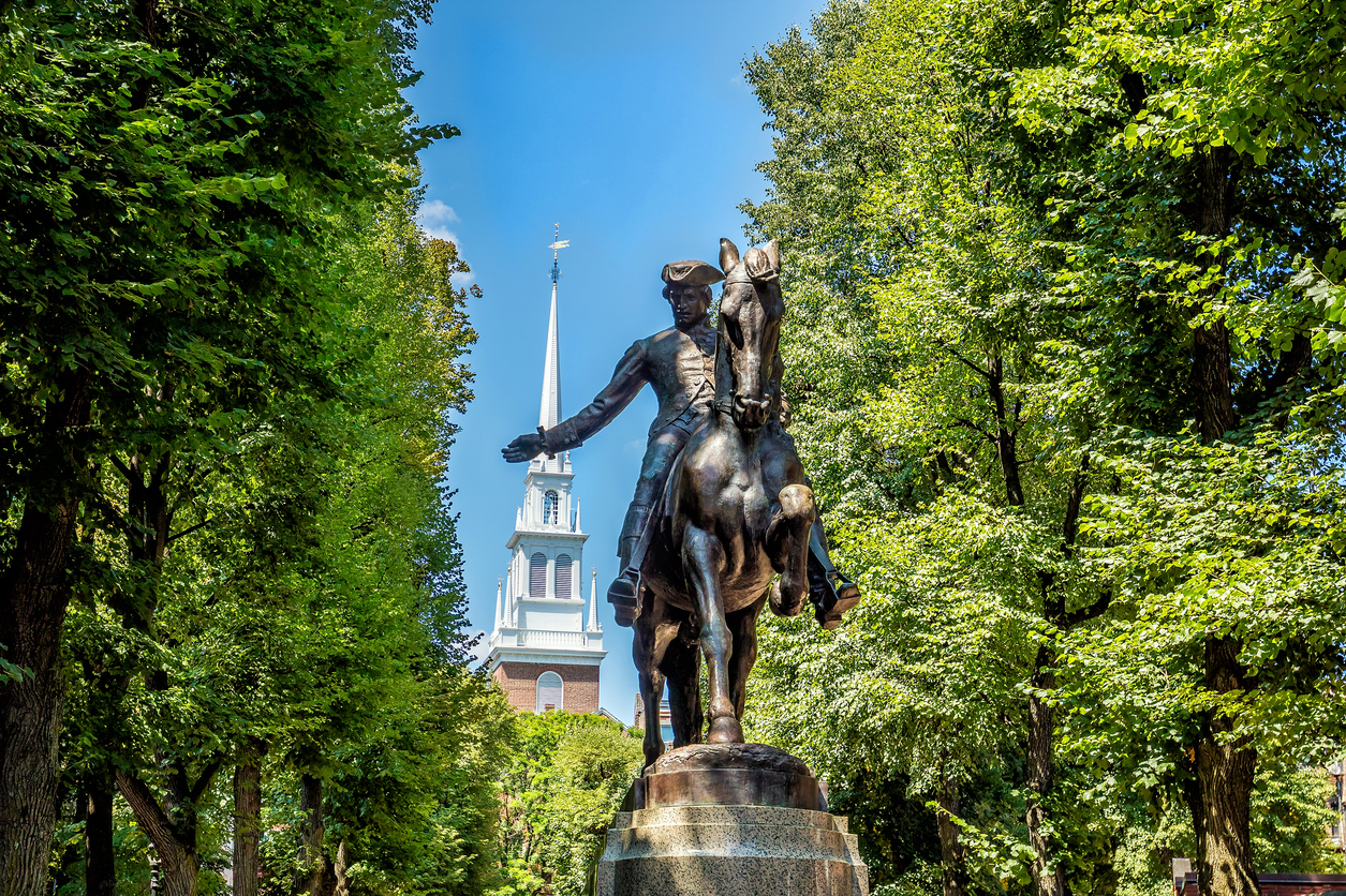 Paul Revere Statue and Old North Church in Boston, Massachusetts with blue sky