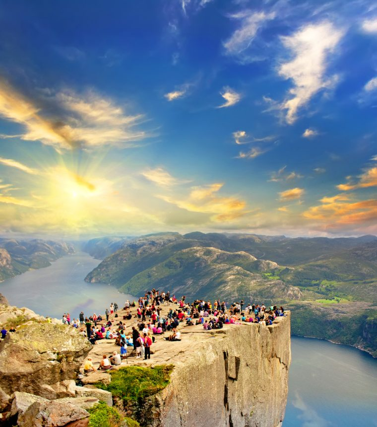 People on the Preikestolen at sunset, Pulpit Rock, Norway